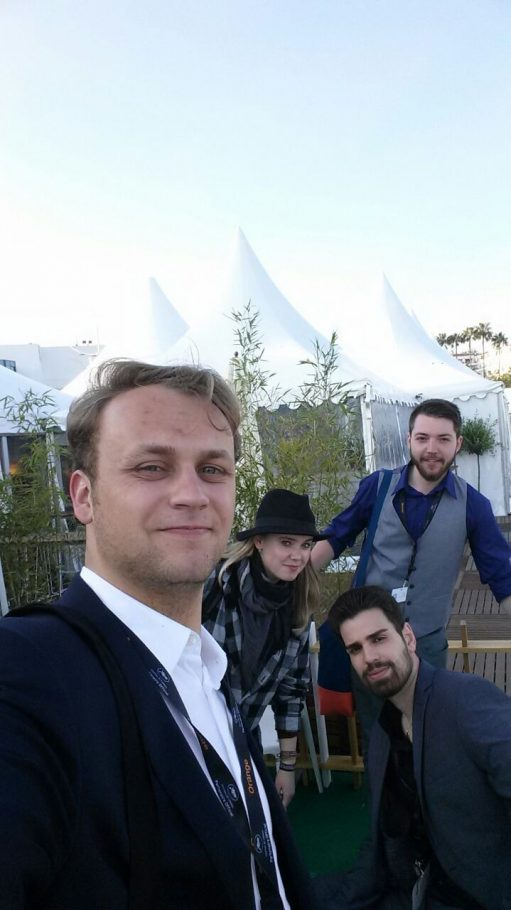 """Crew of """"Marie"""" in front of the festival pavilions"""