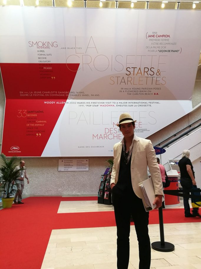 Laurenz in front of a Cannes poster